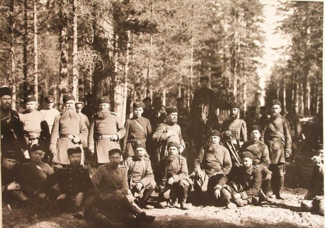 A group of huntsmen in the forest before the start of the Belovezh royal hunt.