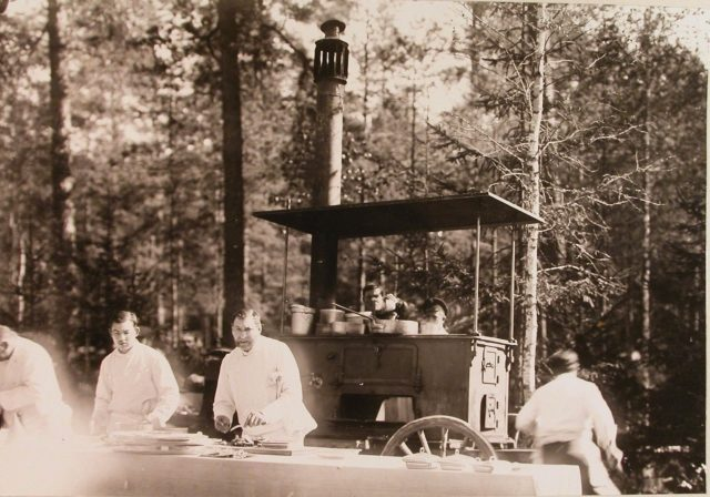 Cooks at the camp kitchen for preparing breakfast for the participants of the Belovezh royal hunting