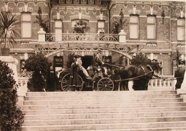 Empress Alexandra Feodorovna in the carriage at the Belovezhsky Palace.