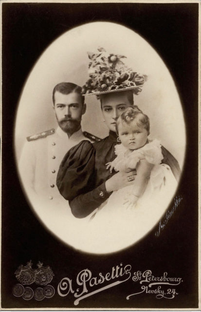 Emperor Nicholas II and Empress Alexandra Feodorovna with Grand Duchess Olga Nicholaevna. 1896.