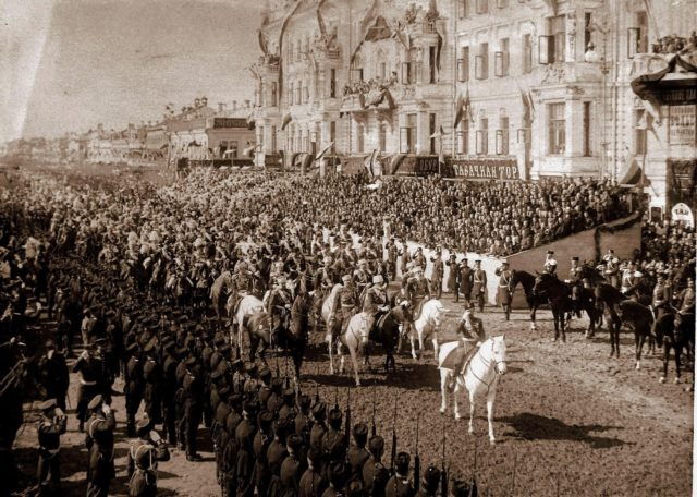 Emperor Nicholas II marches in front of the stands from the Triumphal Gates on Tverskaya Street