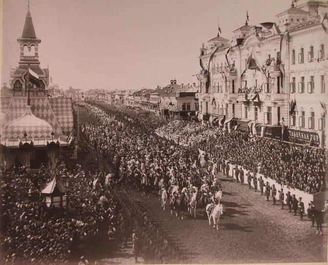 Emperor Nicholas II passes the viewers along Tverskaya Street
