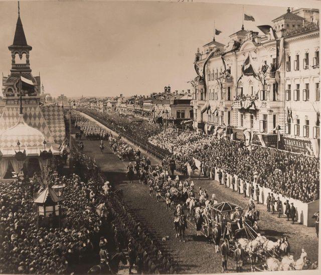 The coronation cortege passes along Tverskaya Street from the Triumphal Gates