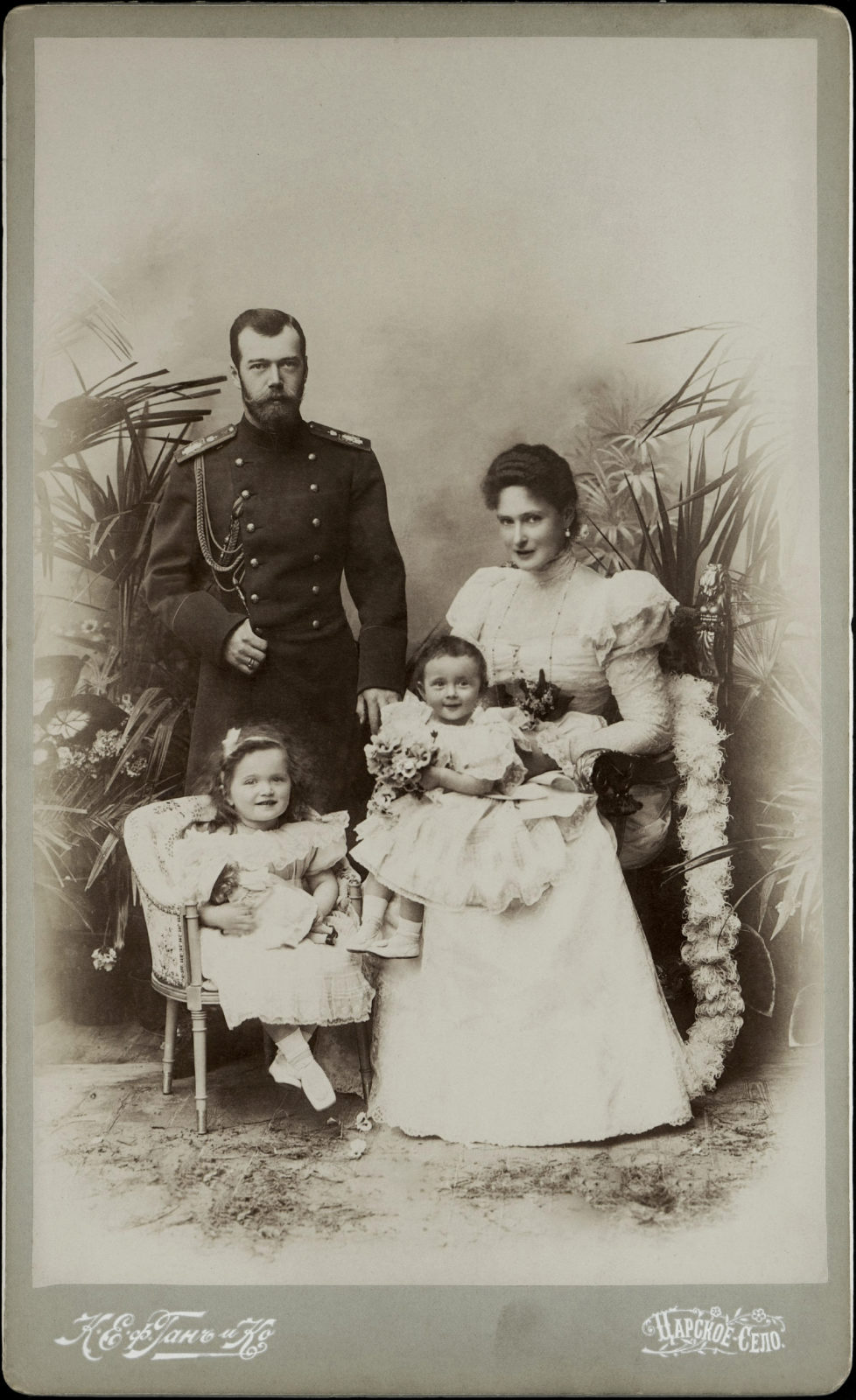Emperor Nicholas II and Empress Alexandra Feodorovna with Grand Duchesses Olga and Tatiana.1898.