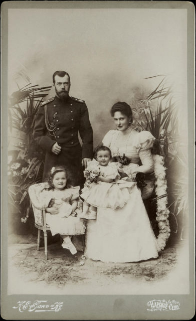 Emperor Nicholas II and Empress Alexandra Feodorovna with Grand Duchesses Olga and Tatiana.1898.