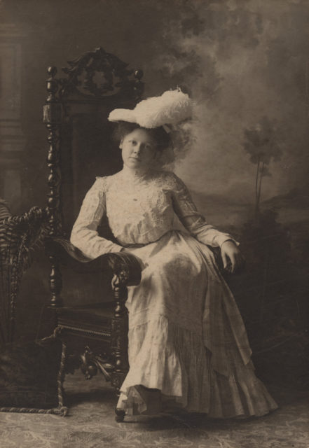 Portrait of young woman with hat, date unknown