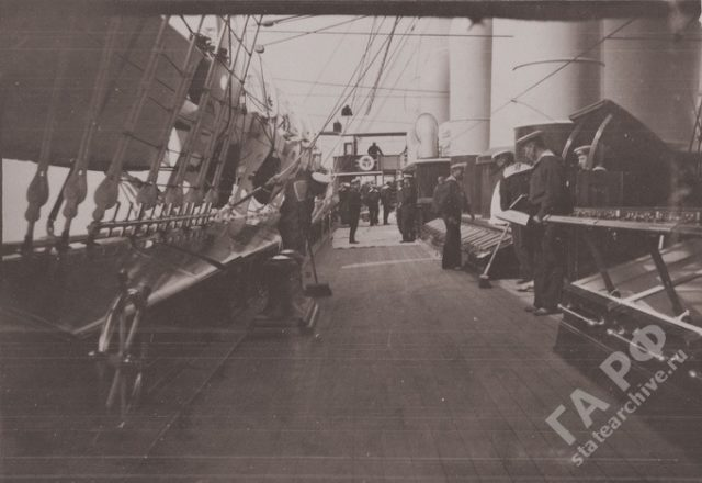 Sailor cleaning the deck. Yacht Standard 1899-1900.
