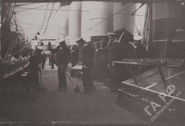 Sailors cleaning the deck. Yacht Standard 1899-1900.