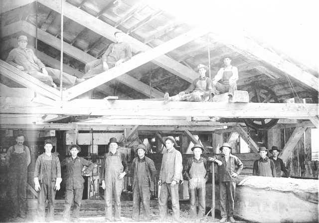 Workers inside a sawmill
