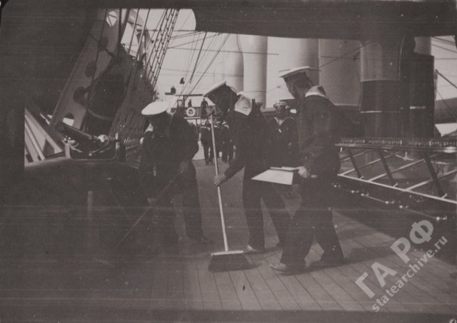 Yacht Standard crew washing the deck 1899-1900.