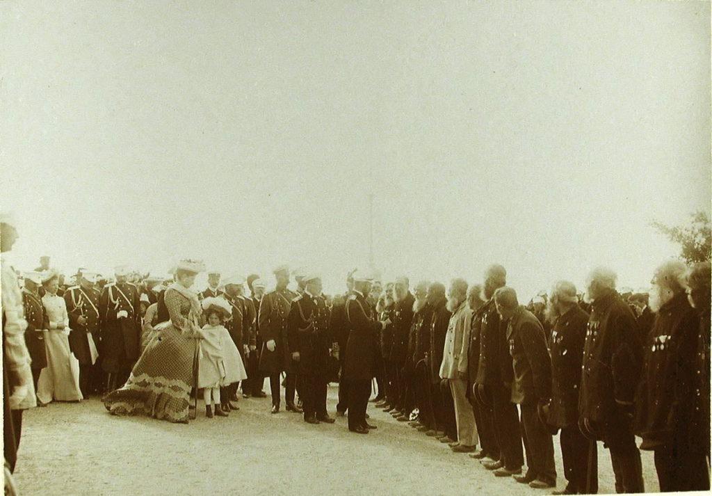 Emperor Nicholas II, Empress Alexandra Feodorovna, Grand Duchess Olga Nikolaevna greet a group of Sevastopol veterans, participants of the Crimean War.