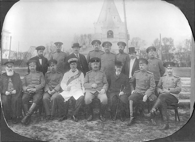 Murom, Group portrait of military and civilians on the background of the church. 1910s