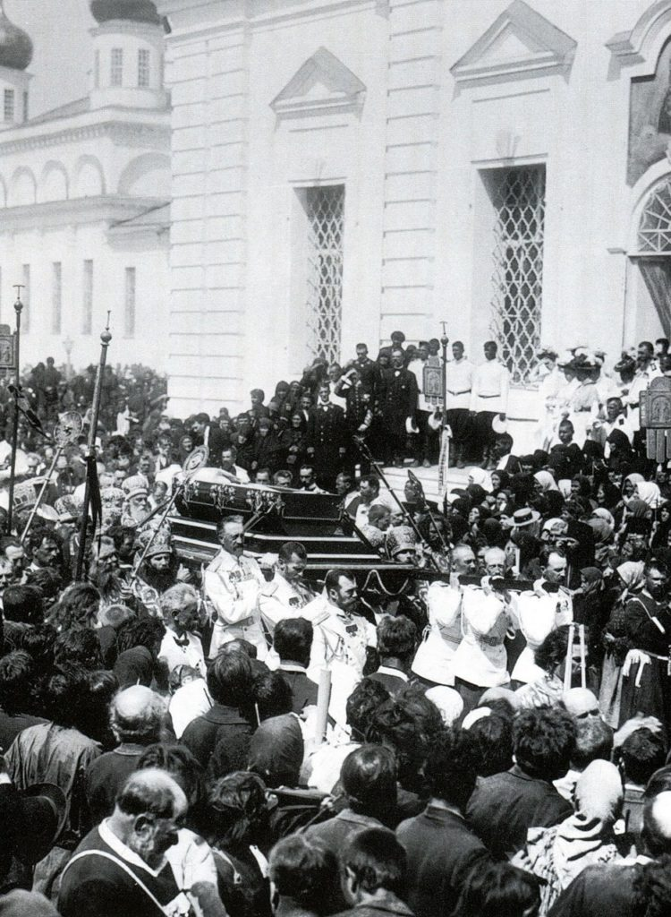 Emperor Nicholas II and the Grand Dukes carry a coffin of Seraphim of Sarov.