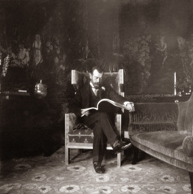 Emperor Nicholas II reading magazine. 1903.