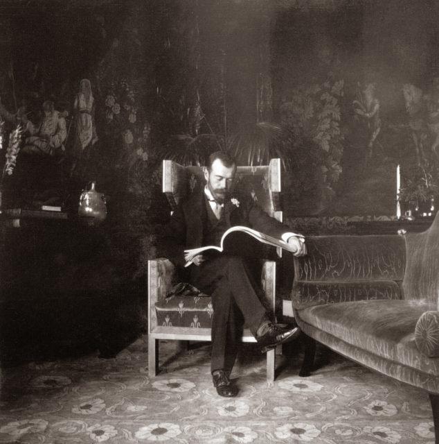 Emperor Nicholas II reading magazine. 1903.