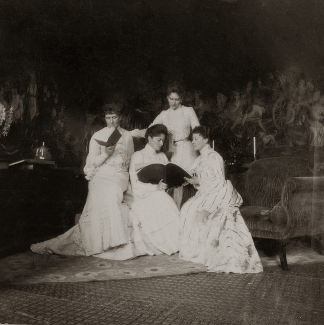 Empress Alexandra Feodorovna with sisters reading a magazine. 1903.