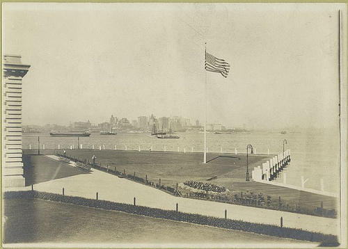 View of Ellis Island lawn, with New York skyline in distance...