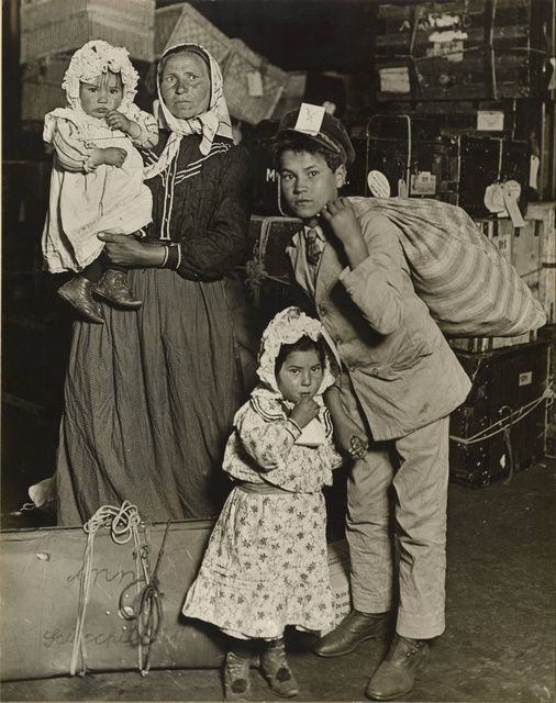 Lewis W. Hine - Immigrant Family in the Baggage Room of Ellis Island