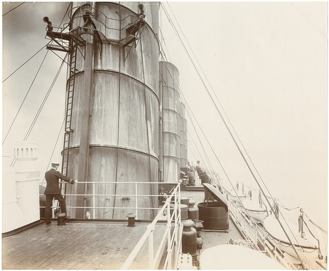 [Officer standing on the navigation bridge, looking aft]