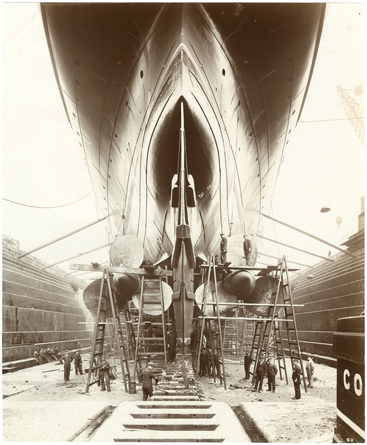 [Stern view of Lusitania on stocks showing the propellers and the launching cradle]