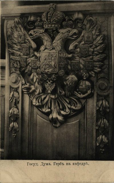 The rostrum of the chairman with Imperial Coat of Arms.