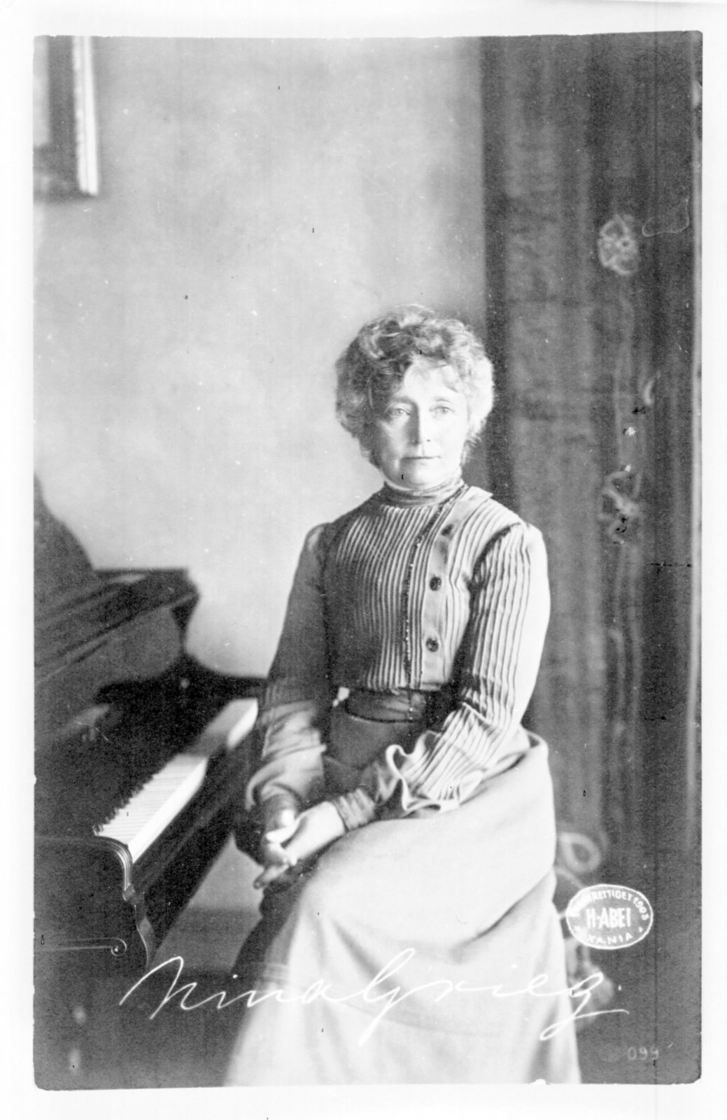 Nina Grieg by the piano portrait