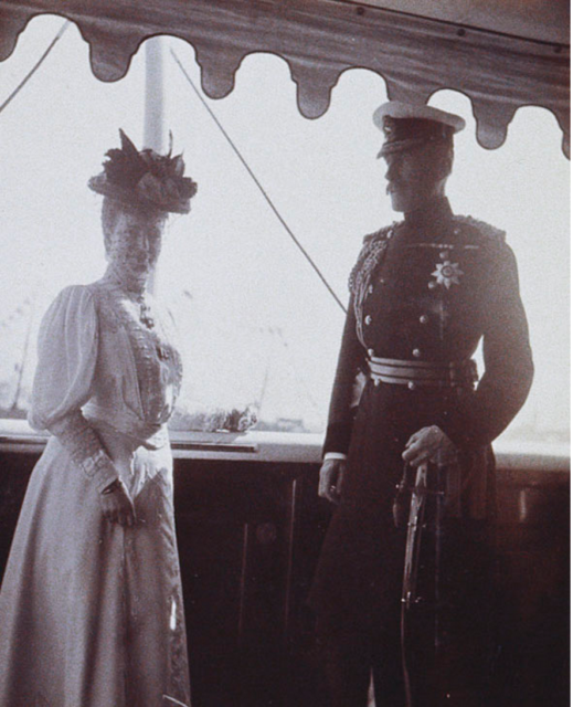 Dowager Empress Maria with an officer on the deck of the Royal Yacht Victoria and Albert.