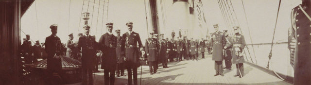 Members of the British and Russian royal families on the deck of the yacht Standard.