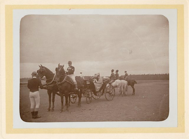 Empress Alexandra Fedorovna and Tsarevich Alexei Nikolayevich in a road carriage accompanied by Cossacks Convoy