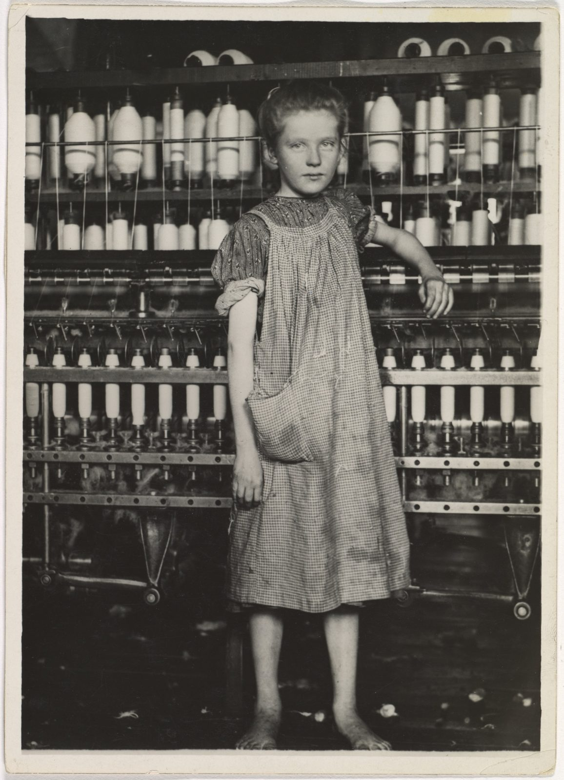"""Addie Card, 12 years. Spinner in North Pownal Cotton Mill. Girls in mill say she is ten years. She admitted to me she was twelve; that she started during school vacation and now would """"stay"""". Location: Vermont"""