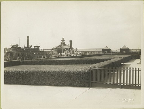 A view of an Ellis Island pier; the boat docked here is mark...