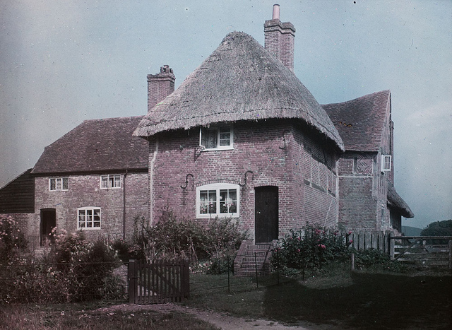 Early Colour image of thatched house now identified as Corhampton, Hampshire. Paget Colour process