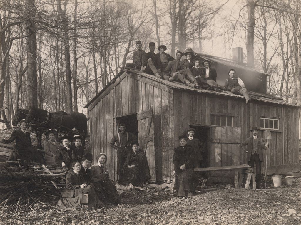Group portrait in front of sugaring shack, 1910