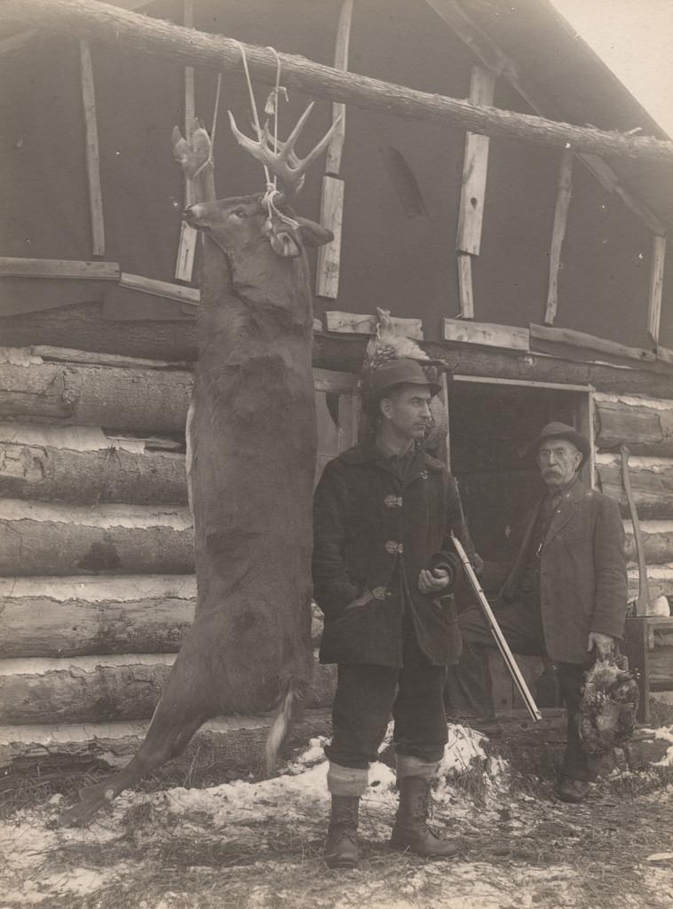 Hanging deer with hunters, 1911