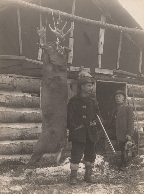 Hanging deer with hunters, 1911