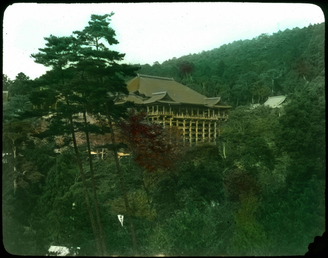 Large building (temple?) in wooded setting.