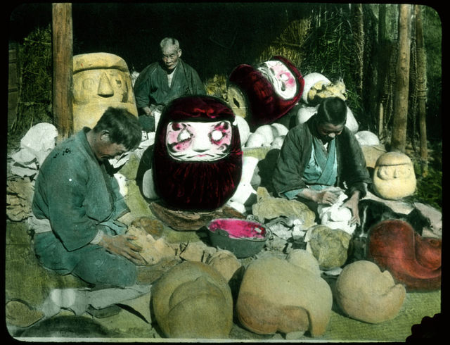 Men making clay moulds for giant masks.