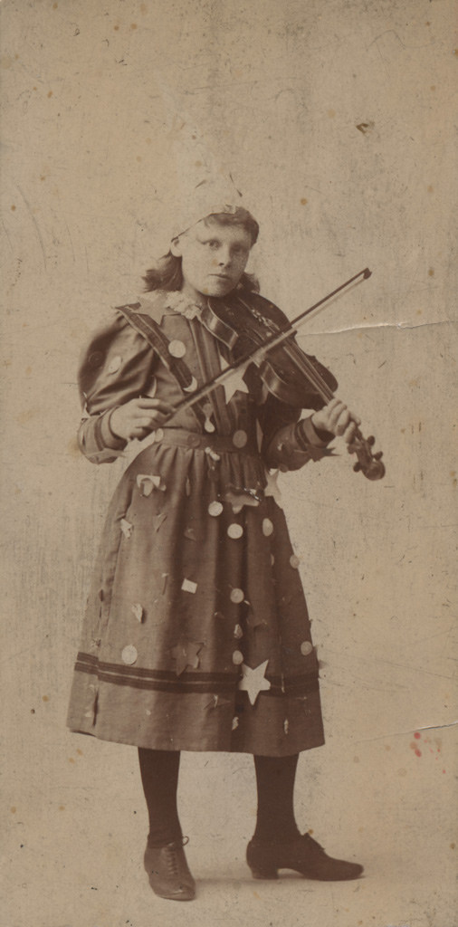 Portrait of girl with violin, date unknown