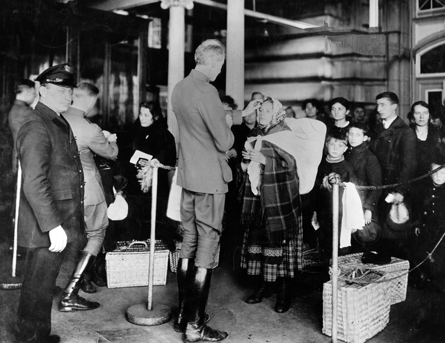Public Health Service officers examining immigrants arriving to Ellis Island