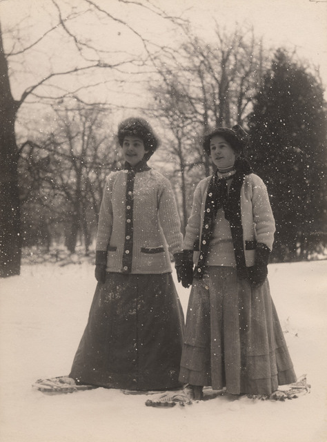Two women standing on snowshoes, 1910