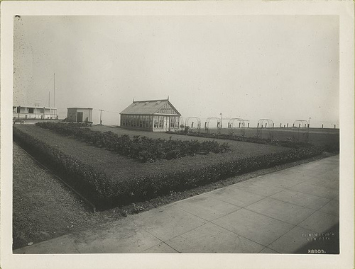 View of garden and greenhouse on Ellis Island.