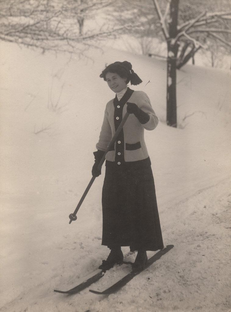 Woman cross country skiing, 1910