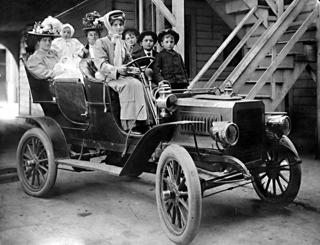 Women and children on an automobile outing
