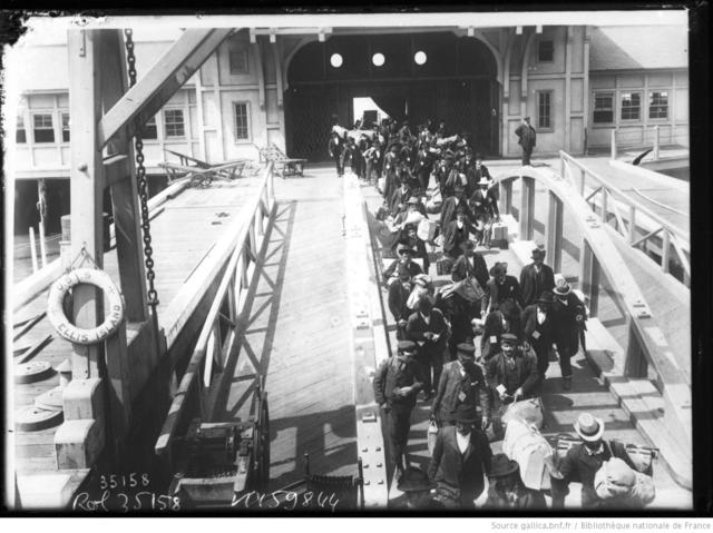 Immigrants leaving for New York from Ellis Island