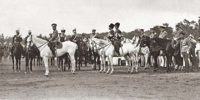 Nicholas II, Grand Duchesses Tatiana and Olga in military uniform.