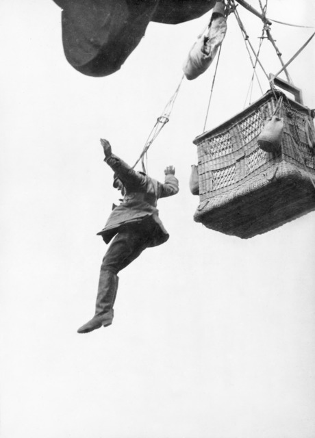 A German soldier jumping from his observation balloon