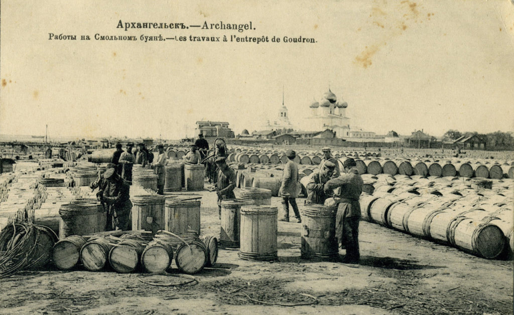 Barrels with tar ready to be loaded