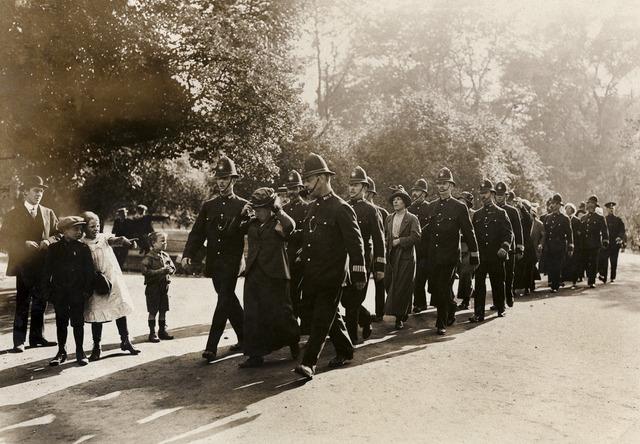 Flora Drummond and others under arrest, 1914.