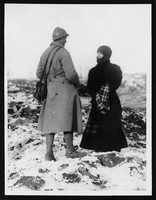 French soldier and his wife returned to one  of the captured villges in search of cash they had buried before the invasion