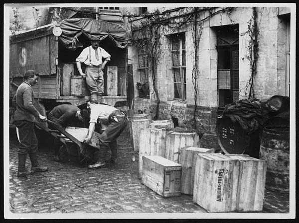 French soldiers removing the wines from the cellars in Amiens into lorries